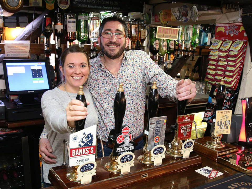 Kelly and Rob behind the bar at Ye Olde Red Lion